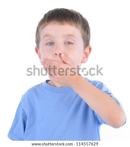 A young boy is holding his hand over his mouth for silence and not talking on a white background. - stock photo