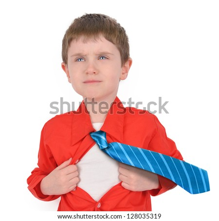 A young boy is holding his shirt open with his tie flying for a super hero rescue concept. His shirt is red and the background is white. - stock photo