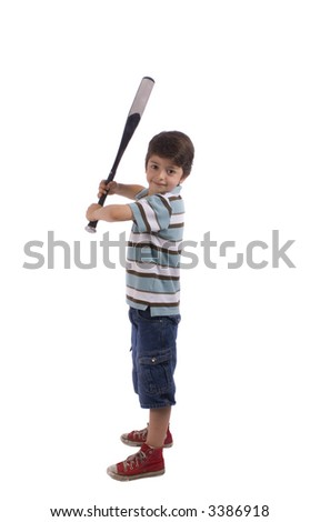 A young boy is ready to swing the bat - stock photo