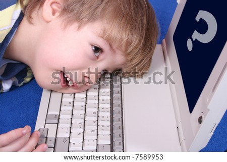 A young boy on a laptop