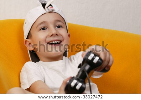 A young boy playing a computer game. - stock photo