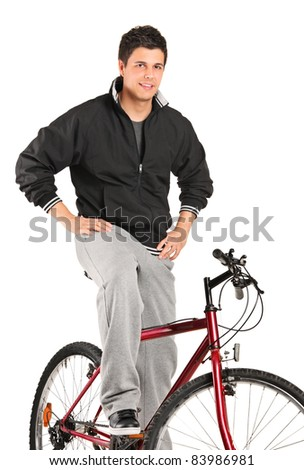 A young boy posing on a bike isolated against white background - stock photo