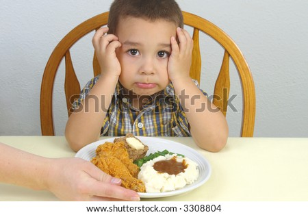 A young boy ready to eat his fried chicken dinner - stock photo
