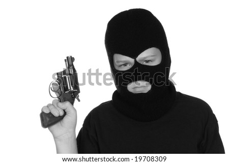 A young boy shows how he is entering a lifestyle of crime and gangs. - stock photo