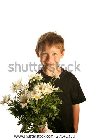 a young boy smiles as he holds a bunch of white daisies isolated on white with room for text - stock photo