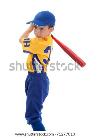 A young boy swings a baseball bat.  White background. - stock photo