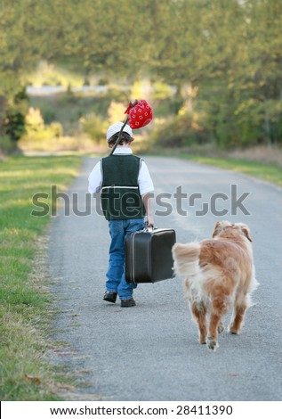 A Young Boy Traveling Away From Home - stock photo