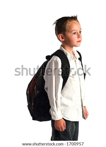 A young boy wearing a backpack