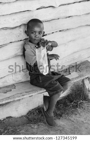A young boy who is wiling to share his sweets. - stock photo