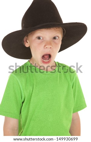 A young boy with a big hat on and a funny expression.