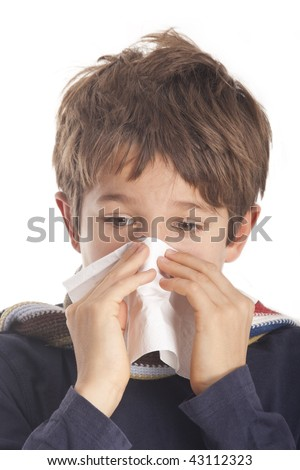 A young boy with a cold - stock photo