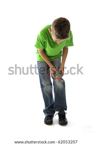 a young boy with a painful leg on white - stock photo