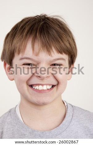 A young boy with a playful snarl expression