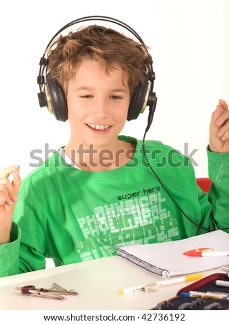 A young boy with headphones listening to music - stock photo