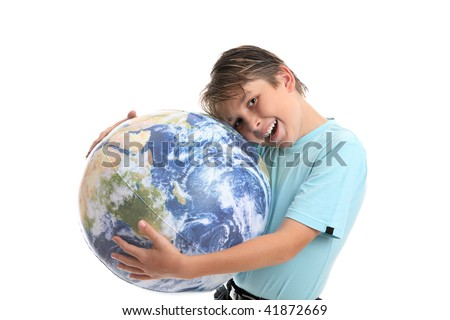 A young boy with his hands hugging the world earth ball.  He is leaning his head into the earth affectionately and smiling.  Concept environmental protection, world care, travel eco-tourism, etc - stock photo