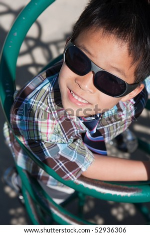 a young boy with sunglasses is smiling