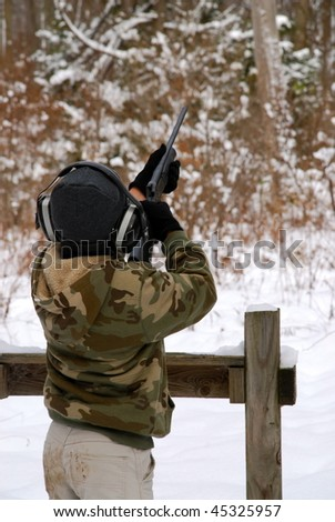 A young boys shooting at sporting clays. - stock photo