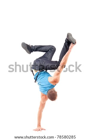 a young break dancer showing his skills on a white background - stock photo