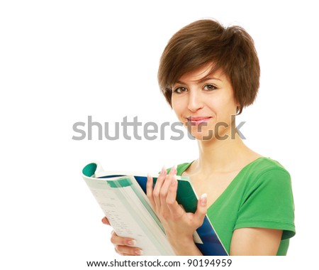 A young brunette woman (student) with books isolated on white background - stock photo