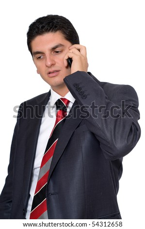 A young businesman speaking on the phone on a white background. - stock photo
