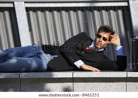 a young business man is enjoing his breaktime, while listening to music