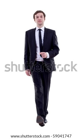 A young business man is walking. He is smiling and looking to the camera. isolated over white background - stock photo