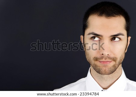 A young business man, isolated on black - stock photo