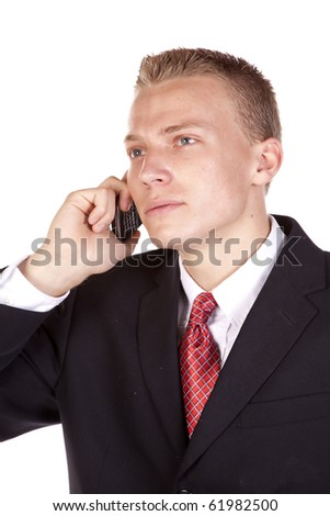 A young business man listening on his phone with a serious expression. - stock photo