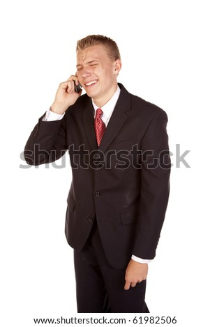 a young business man on his phone not liking the news he is crying. - stock photo