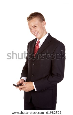 a young business man texting on his phone with a happy expression on his face. - stock photo