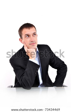 A young business man thinking - stock photo