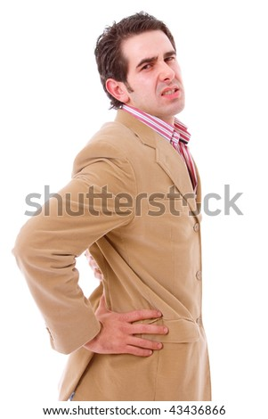 A young business man with a backache, isolated on white background - stock photo