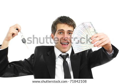 A young business  man  with his money and car keys on a white background - stock photo