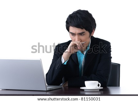 A young business man worrying about his work with laptop computer - stock photo