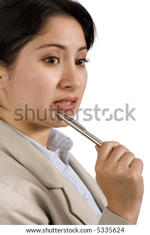 A young business woman holding a pen while thinking
