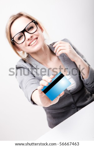 a young business woman holding new credit card