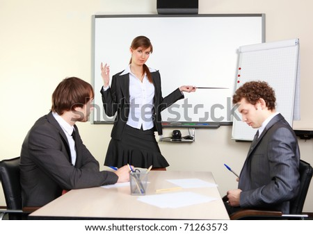 a young business woman making presentation in an office