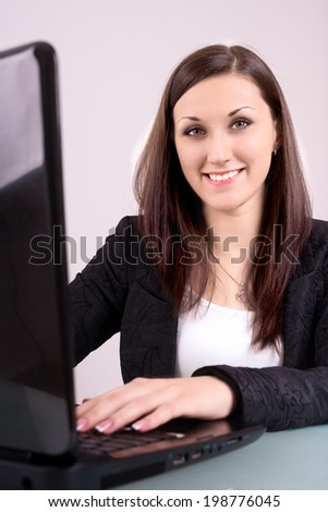 a young business woman sitting at her laptop and check your Commercial ventures have given everything runs according to his plan / young business woman
