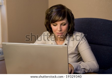 A young business woman working on a laptop