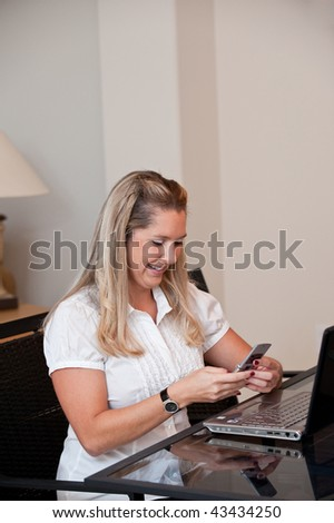 A young business woman working on her computer at a desk - stock photo