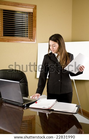 A young business woman working on her laptop