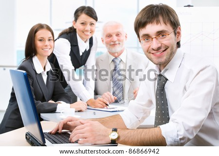 A young businessman and his colleagues in background - stock photo