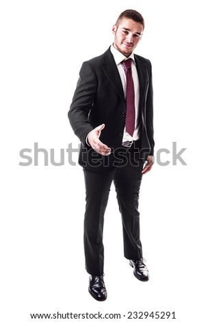 a young businessman greeting and preparing for handshake isolated over a white background