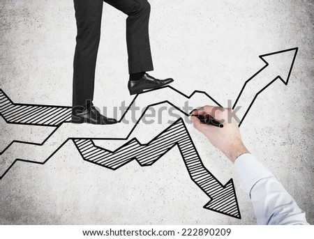 A young businessman has chosen the right direction for the business development.  - stock photo