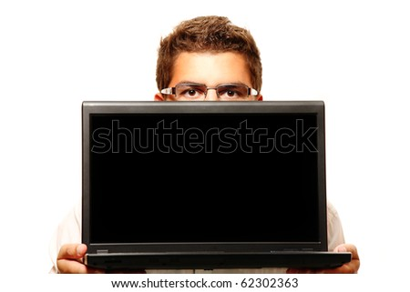 A young businessman holding a laptop over white background - stock photo