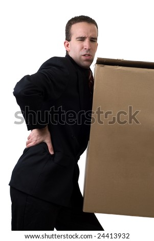 A young businessman hurt his back after trying to lift something to heavy, isolated against a white background - stock photo