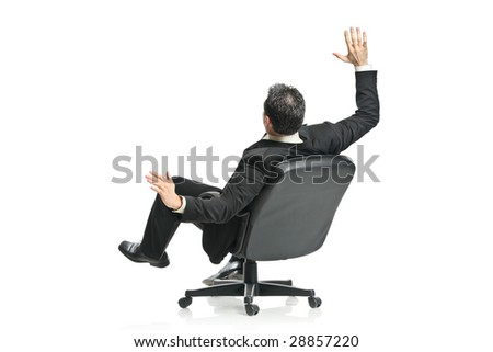 A young businessman in a chair isolated on a white background - stock photo