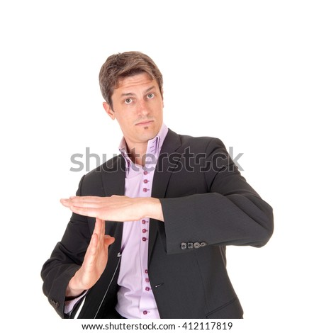 A young businessman in a dark suit and over shirt signs lets talk aboutthis with a serious face, isolated for white background. - stock photo