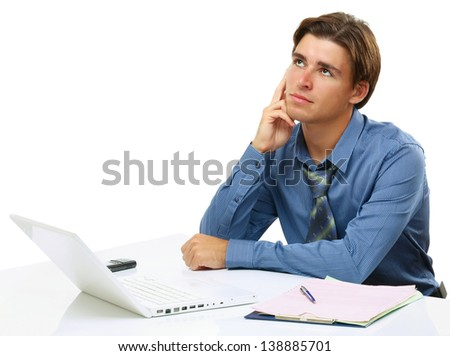 A young businessman in front of a laptop, isolated on white, back-view - stock photo