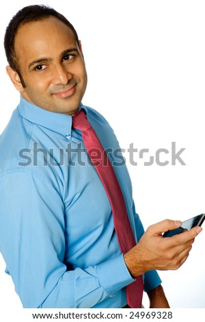 A young businessman in shirt and tie holding a touchscreen phone
